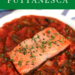 Salmon Filet sitting on savory red puttanesca sauce on a white plate. salmon is garnished with fresh oregano leaves.